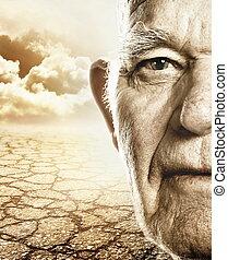 Älteres Gesicht über trockenem Wüstenland