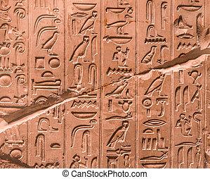 Alte ägyptische Hieroglyphen an der Wand.