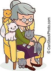 Alte Frau im Sessel mit Katzen