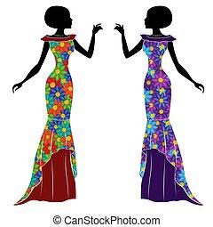 Anmutige junge Damen in langem Kleid.