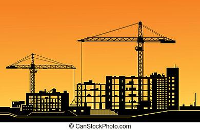 Arbeitende Krane auf der Baustelle