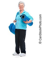 Attraktive ältere Frau im Fitnessclub,