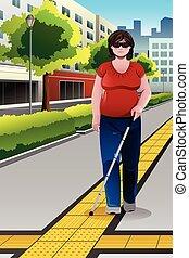 Blinde Menschen gehen auf dem Bürgersteig.