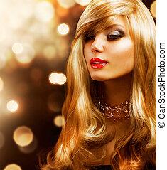 Blondes Modemädchen. Blonde Haare. Goldener Hintergrund