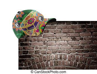 Blumen-Power-Hut an der Mauer