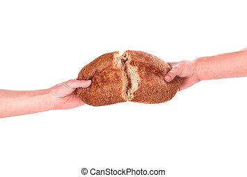 Brot in der Hand.
