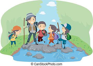 Camper überqueren einen Fluss