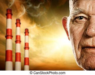 Das Gesicht eines älteren Mannes. Kraftwerke im Hintergrund