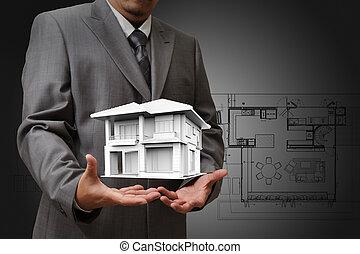 Das Haus in den Händen.