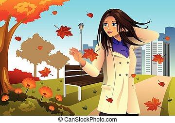 Das Herbstmädchen läuft im Park.
