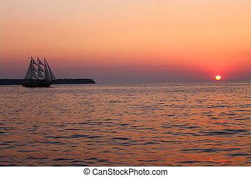 Das Segelschiff und der Sonnenuntergang.