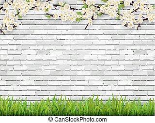 Der blühende Baumzweig auf weißem Backstein Hintergrund
