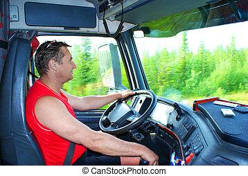 Der Fahrer am Steuer des Trucks