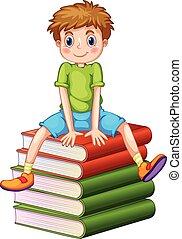 Der kleine Junge sitzt auf einem Stapel Bücher.