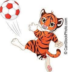 Der kleine Tiger trifft den Ball.