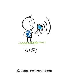 Der Mann mit dem Laptop, der über Wi Fi mit dem Internet verbunden ist