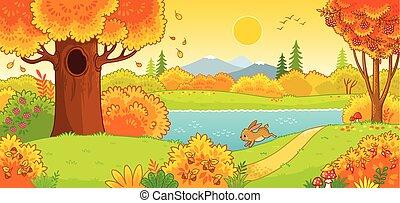 Der süße Hase läuft durch den Herbstwald.