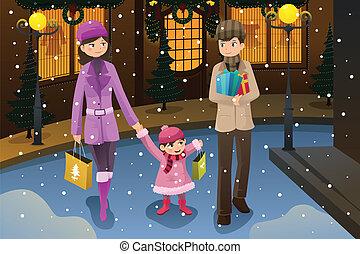 Die Familie macht Weihnachtseinkäufe