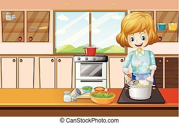 Die Frau kocht in der Küche.