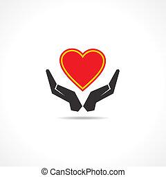 Die Hand schützt eine Herz-Ikone