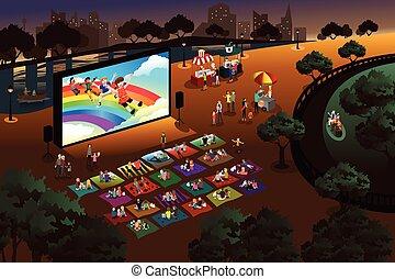 Die Leute sehen sich im Park einen Film an.