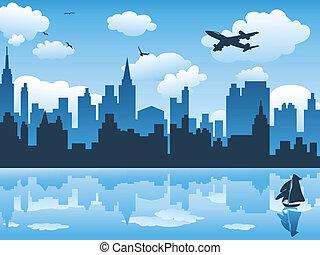 Die Stadt im blauen Himmel und ihr Spiegelbild auf Wasser