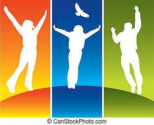 Drei junge Leute springen.