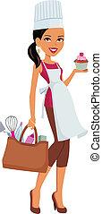 Dunkles Hautmädchen mit Cupcake