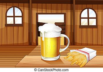 Ein Becher kaltes Bier und Pommes in der Saloonbar