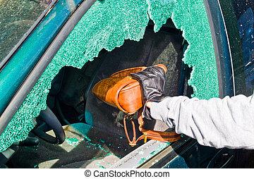 Ein Dieb stahl eine Handtasche aus dem Auto.