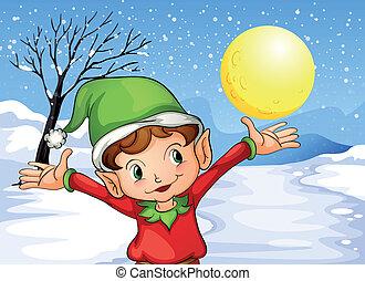Ein Elf hebt draußen seine Hand mit Schnee