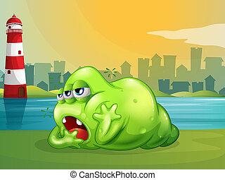 Ein fettes, grünes Monster über dem Leuchtturm