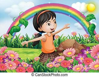 Ein glückliches Mädchen im Garten mit frischen Blumen