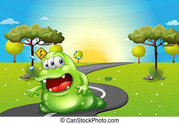Ein grünes, fettes Monster reist