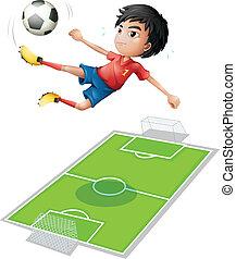 Ein Junge, der den Ball tritt