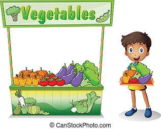 Ein Junge, der Gemüse verkauft