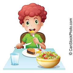 Ein Junge, der isst.