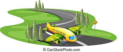 Ein Junge mit einem Flugzeug an der langen Wicklungsstraße.