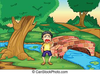 Ein Junge weint allein