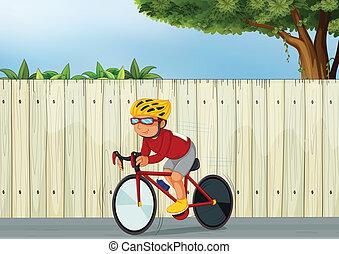 Ein junger Junge, der Fahrrad fährt.