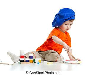 Ein junges Künstlerkind mit Farbe und Pinsel