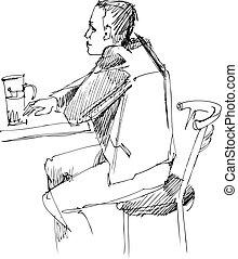 Ein Kerl am Tisch mit einem Glas Bier