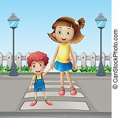 Ein kleines Kind und ein Mädchen, das die Fußgängerzone überquert.