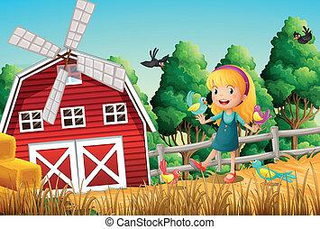 Ein lächelndes Mädchen auf der Farm mit den Vögeln.