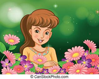 Ein lächelndes Mädchen im Garten mit Blumen