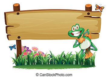 Ein leeres Holzschild mit einem verspielten Frosch.