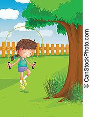 Ein Mädchen, das mit einem Seil im Garten spielt