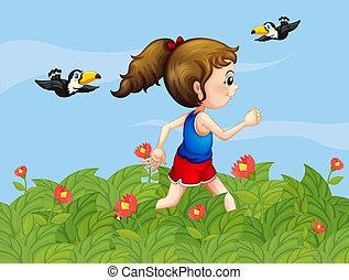 Ein Mädchen, das mit Vögeln im Garten spazieren geht