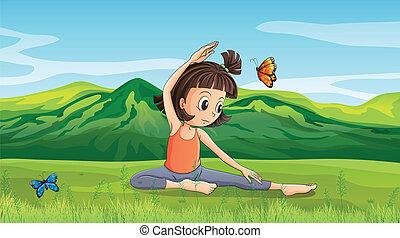 Ein Mädchen macht Yoga in der Nähe der Hügel
