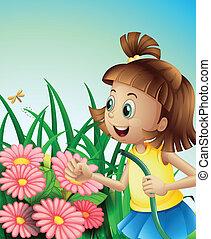 Ein Mädchen mit einem Schlauch im Garten